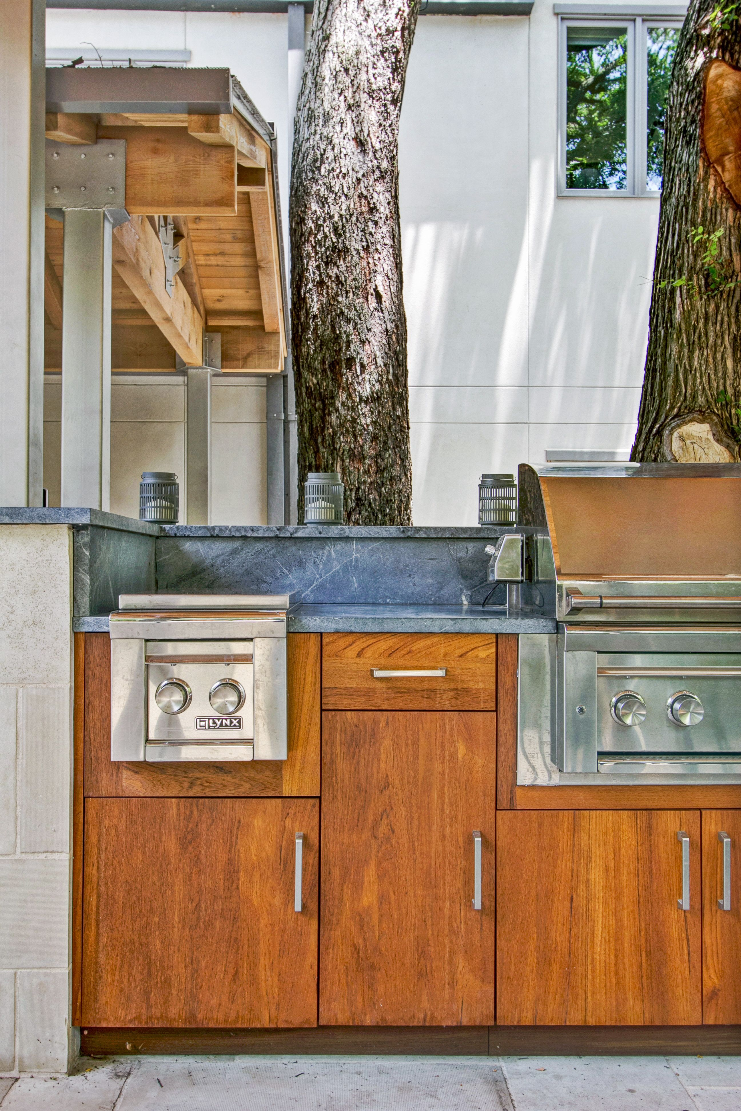 "Teak cabinets with slab door | Lynx 54"" grill, double side ..."