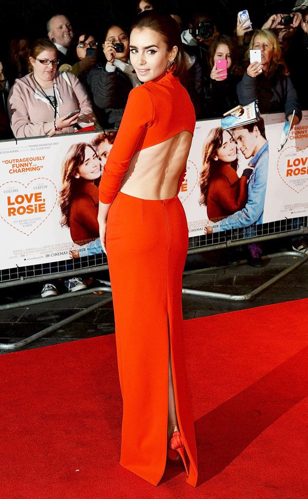 Lily Collins looks red hot on the red carpet. Someone's definitely bringing sexy back!
