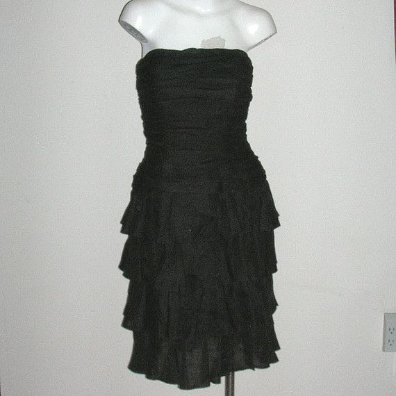 Spectacular vintage strapless layered ruffled cocktail or evening dress by A.J. Bari in fabulous black silk organza. This dress is super flattering on