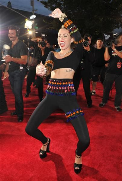 """Miley Cyrus' VMA performance has Adam Lambert and Paula Patton's support… At least in theory. """"Listen if it wasn't ur cup of tea – all good but why is everyone spazzing? Hey – she's doin something right. We all talkin,"""" Lambert tweeted on Monday. But the """"American Idol"""" alumnus later clarified his comments, pointing out that he wasn't necessarily a fan of her racy Robin Thicke collaboration, he just thought she deserved some props for taking a risk. """"I didn't actually state whether or not I…"""
