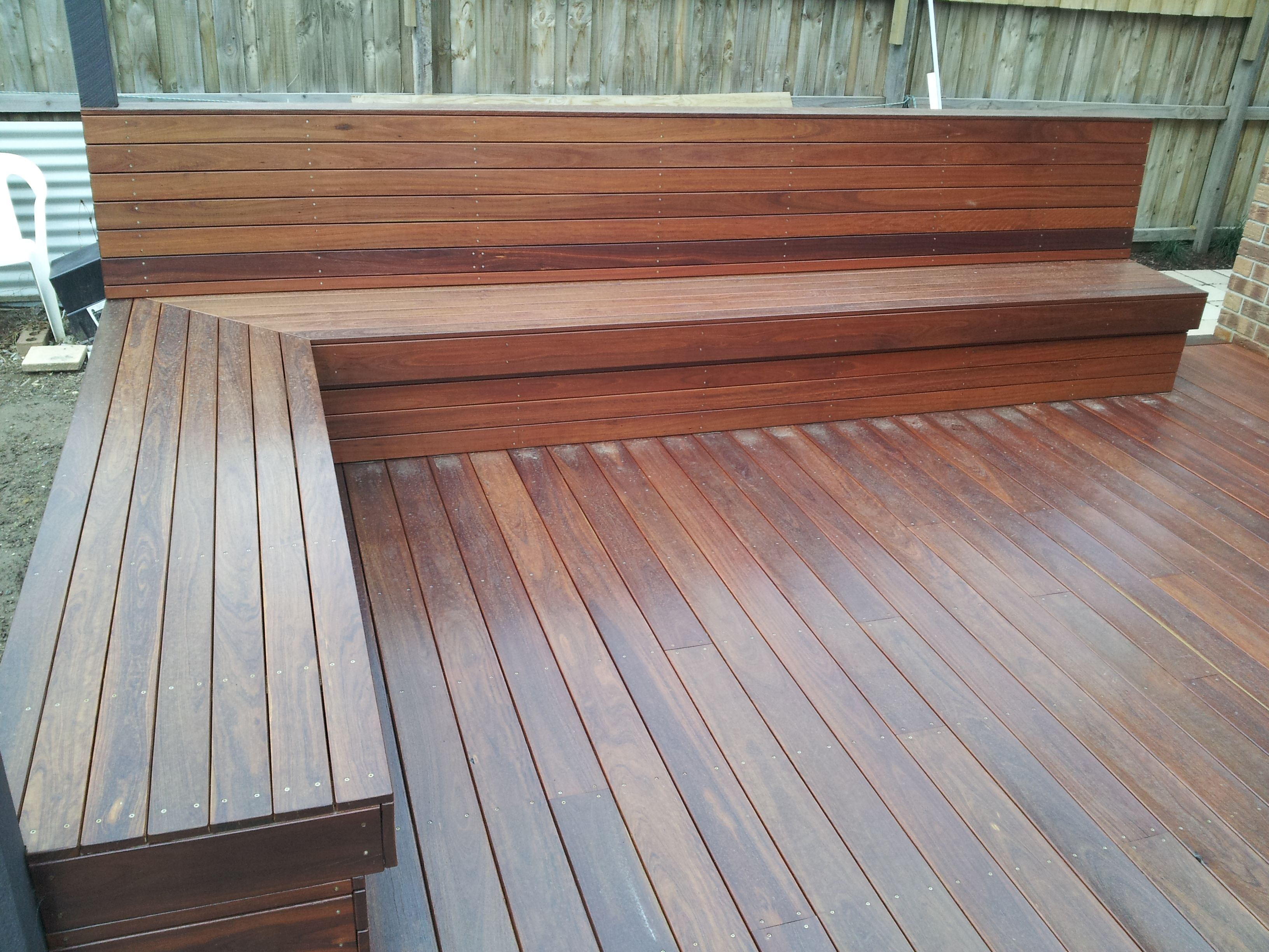 Installation Of A New Outdoor Deck With Seats Diy Deck Wood Plastic Composite Deck Design