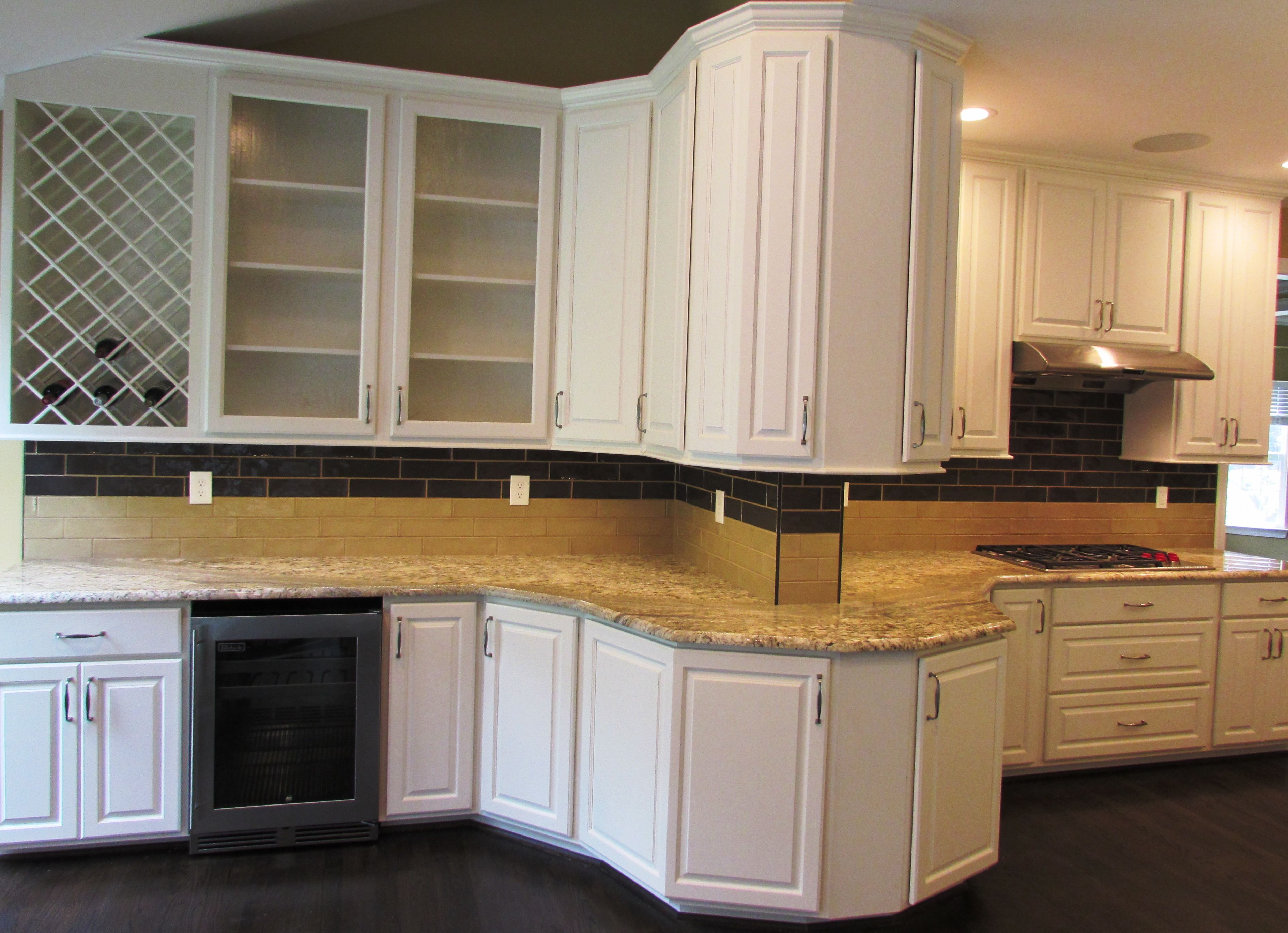New kitchen remodel in new market md with white cabinetry and a wine cabinet with a beverage cooler