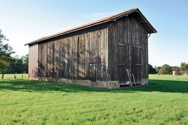 Un ancien séchoir à tabac rénové en maison moderne Barn