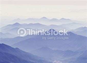 Search for Stock Photos of Mountains And Mist on Thinkstock
