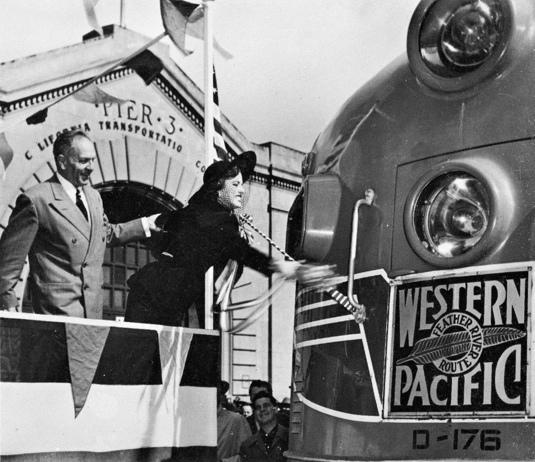 """Eleanor Parker christens the """"California Zephyr""""...she broke the champagne bottle on the nose of the California Zephyr train, to mark its inaugural journey from San Francisco on March 19, 1949"""