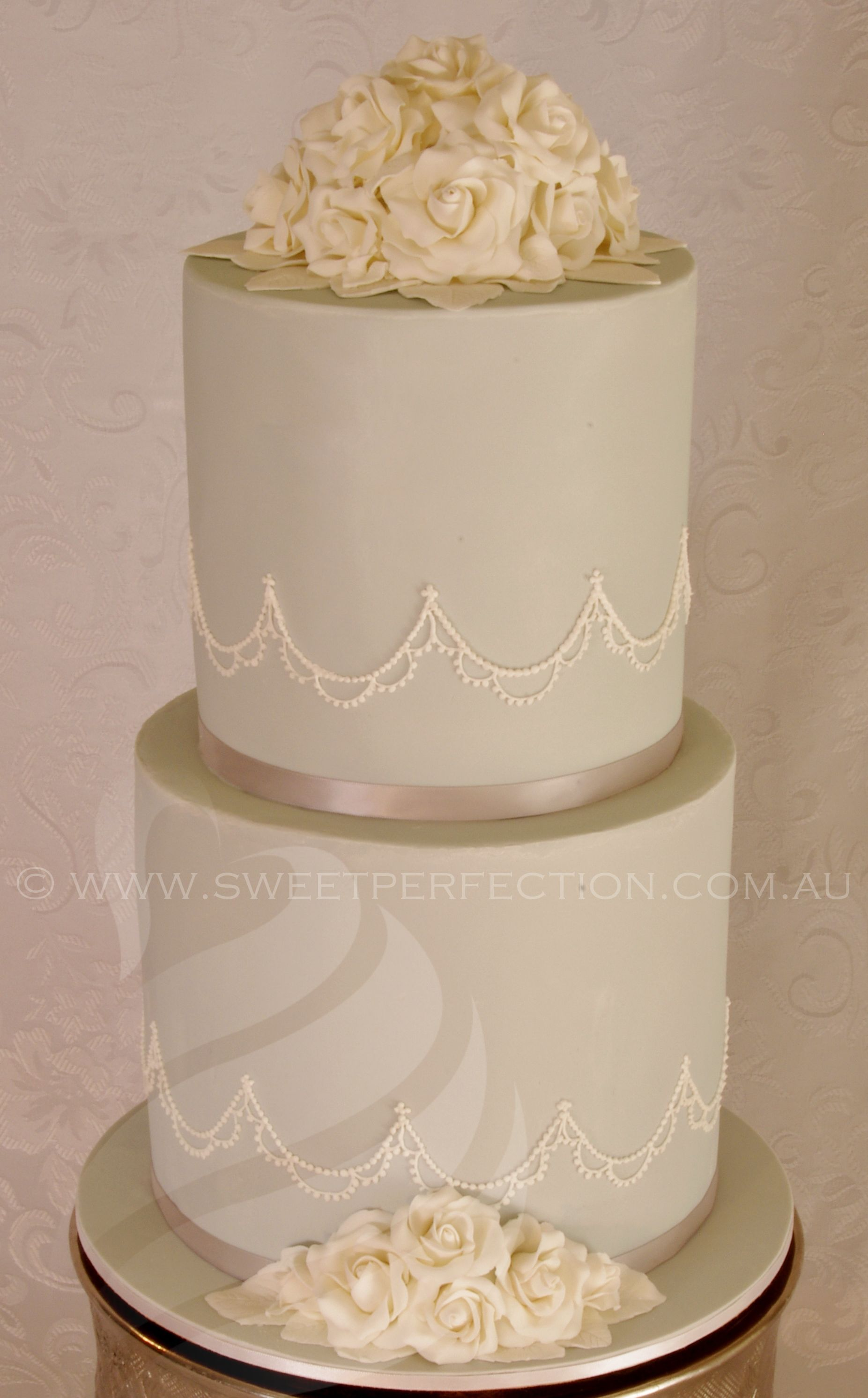 Pale blue/grey wedding cake with fine royal icing piping and ivory ...