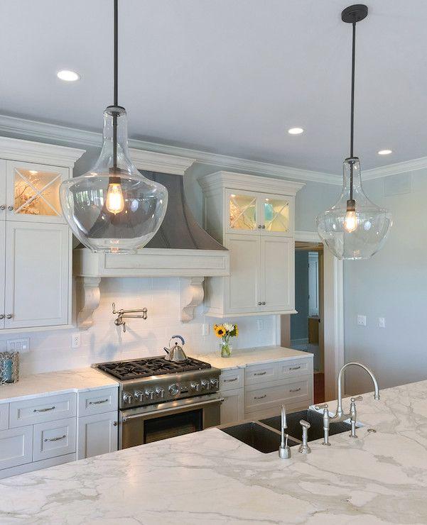 Simple Elegant White Kitchen Distressed Gray Hood Blue Wall