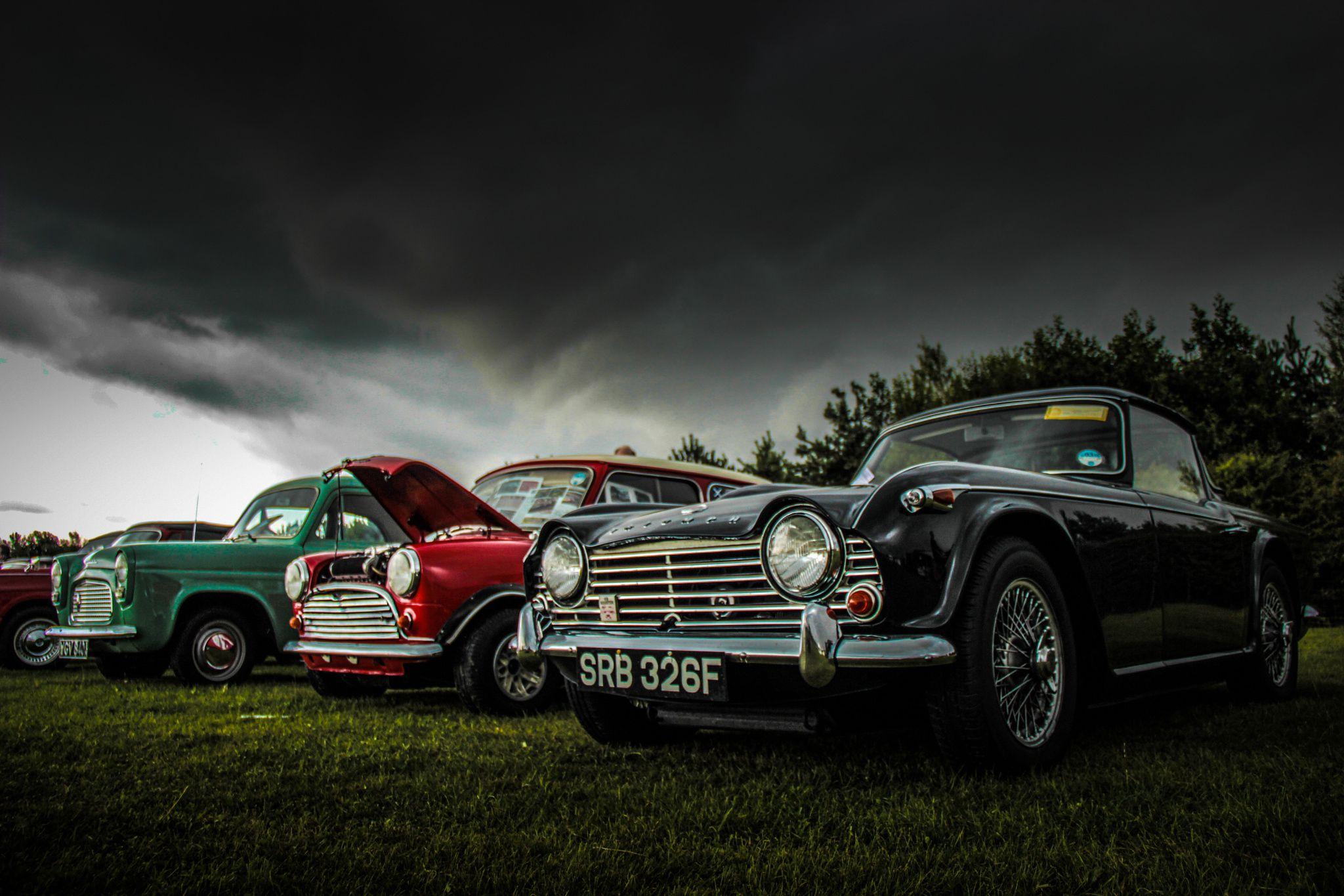 Vintage Brits - Lineup of old British cars. Mini, Ford Anglia and ...