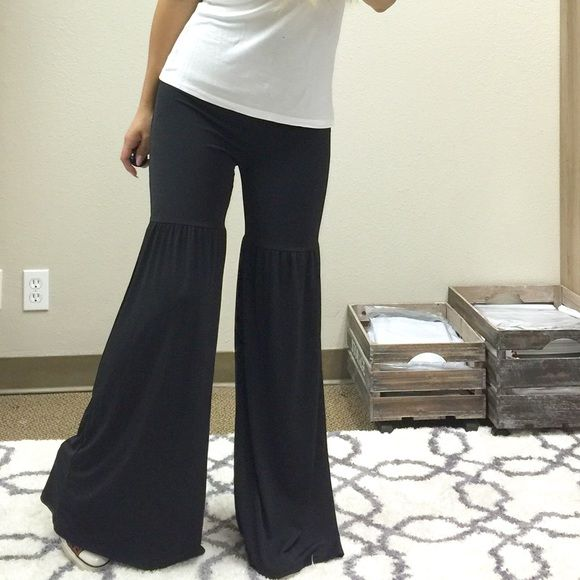 New Tiered Palazzo Bell Bottoms S M L Amazing wide leg palazzo pants with a tier stitched at mid thigh. Soft and comfortable has a stretch   Waist can be worn up or folded over.   Please message with questions   Similar styles- free people urban outfitters Nastygal revolve clothing novella Royale Pants Boot Cut & Flare