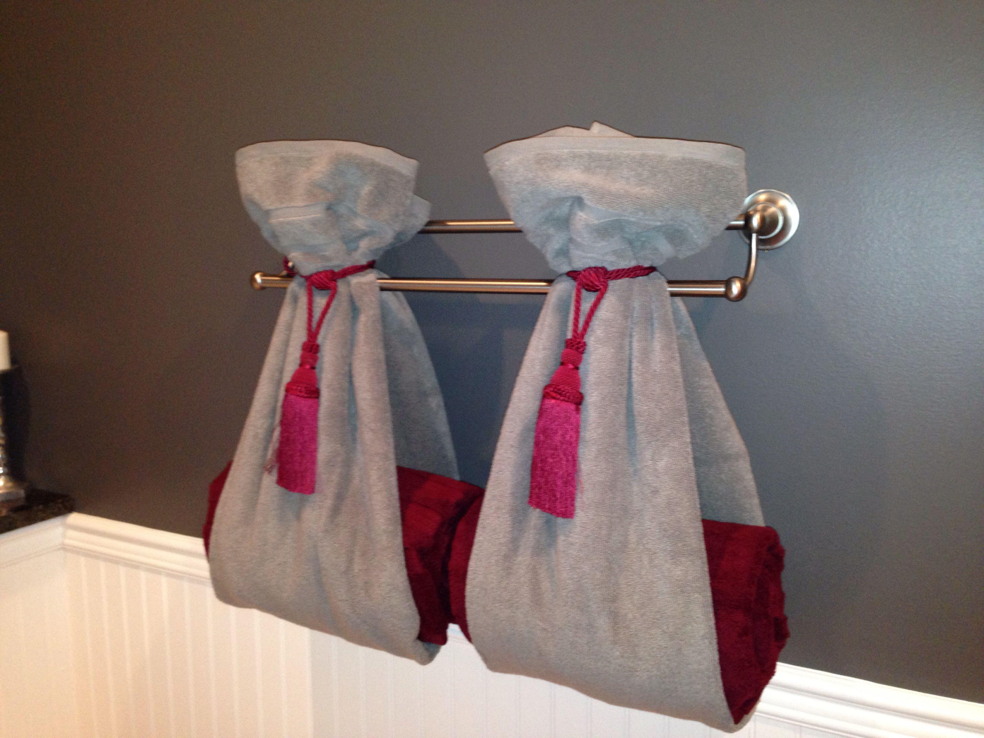A Different Way To Hang Towels Using Curtain Tie Backs Decorative Towels Bathroom Towel Decor Hanging Bath Towels