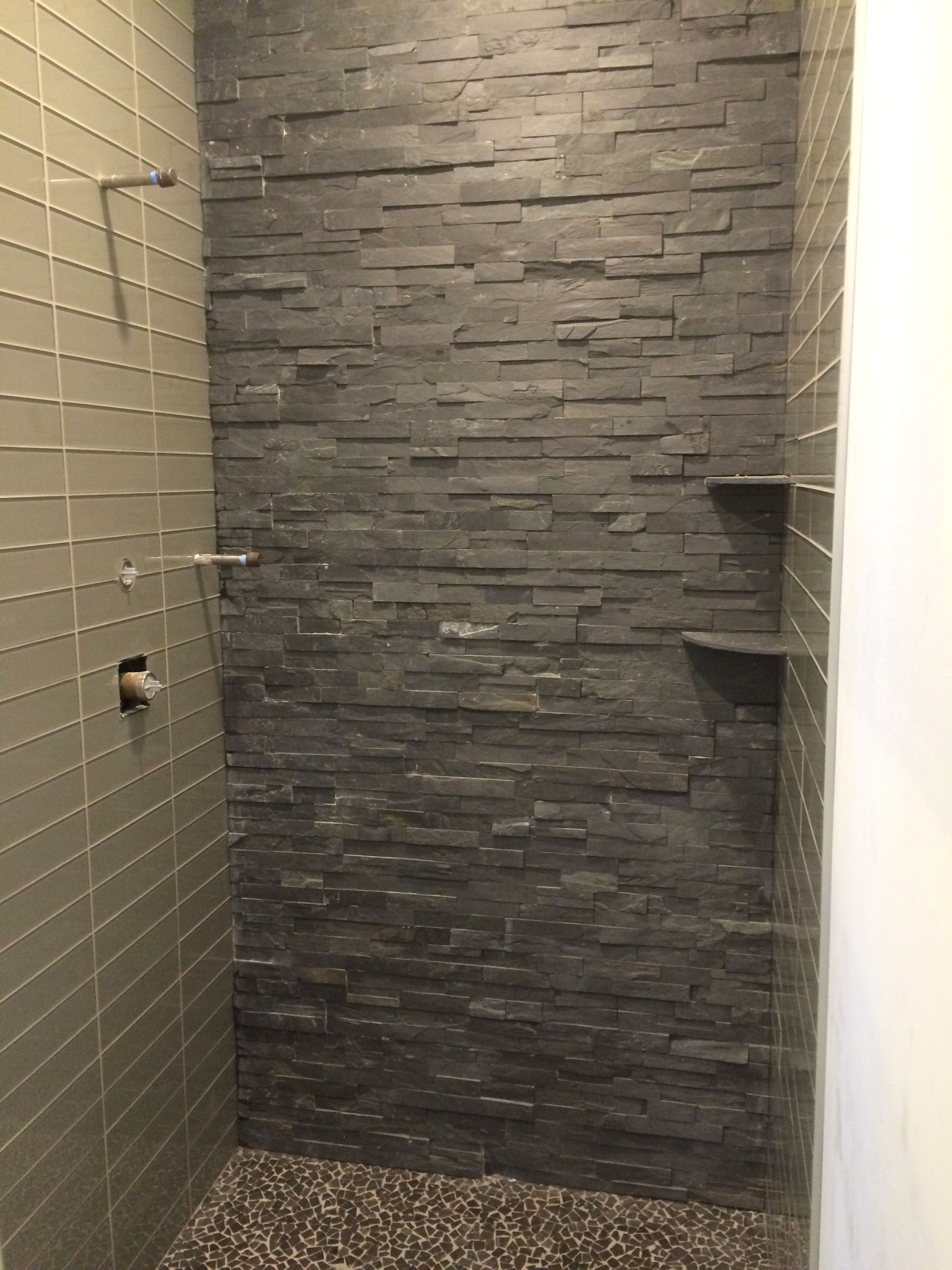 Ledgerstone and subway tile walk in shower with pebble floor and     Ledgerstone and subway tile walk in shower with pebble floor and corner  shelves  Tile  Arley Wholesale Installation  Old World Tile by John Damiano