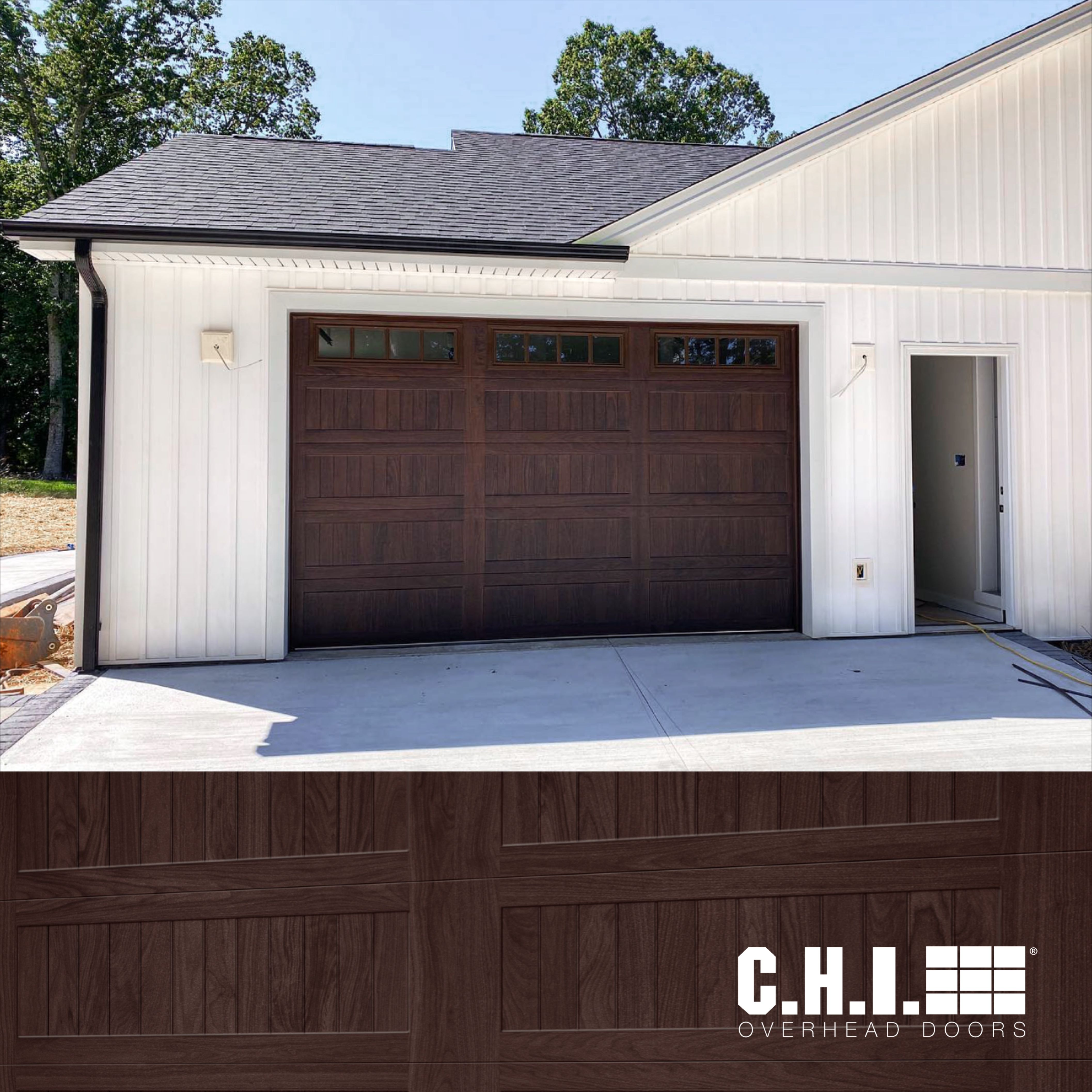 Faux Wood Stamped Carriage House Garage Door On White Exterior Walnut Carriage Style Garage Doors Garage Doors Garage Door Styles