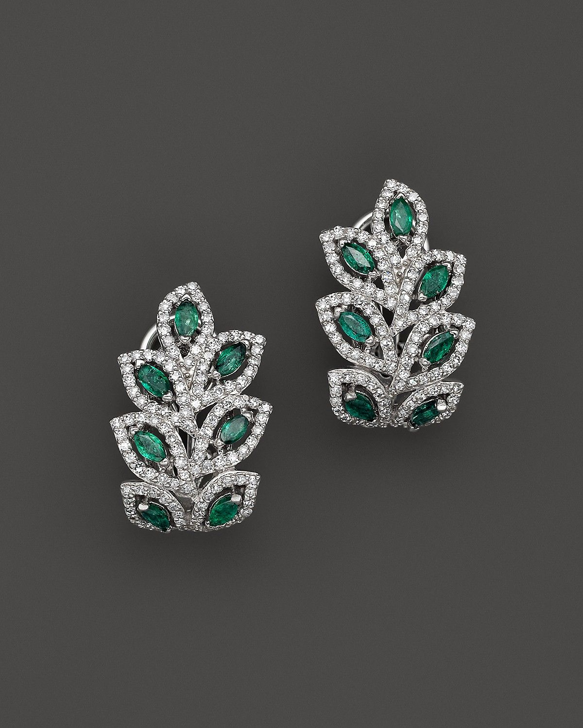 Emerald and diamond leaf post earrings in k white gold