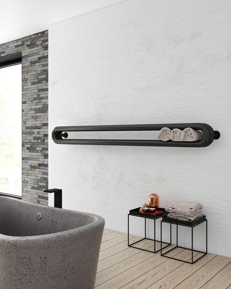 De fraaie designradiator tubone bewijst dat warmte heel erg mooi kan zijn een radiator met also   strakke vormgeving interieurs white bathroom black rh pinterest