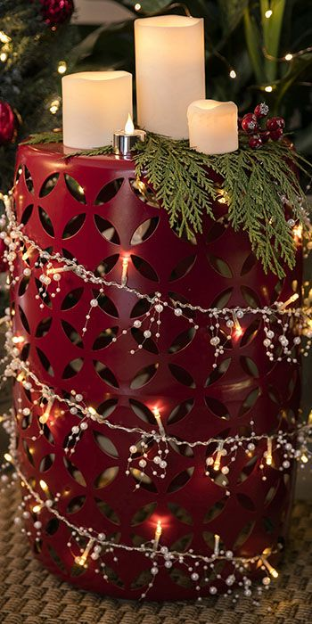 a red plant stand wound with string lights and topped with battery operated candles chistmas pinterest battery operated christmas lights and porch