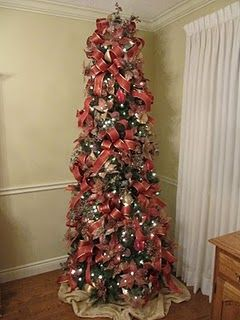 A decorated 7 1/2 foot slim Christmas tree ~ think I will buy a slim tree this year