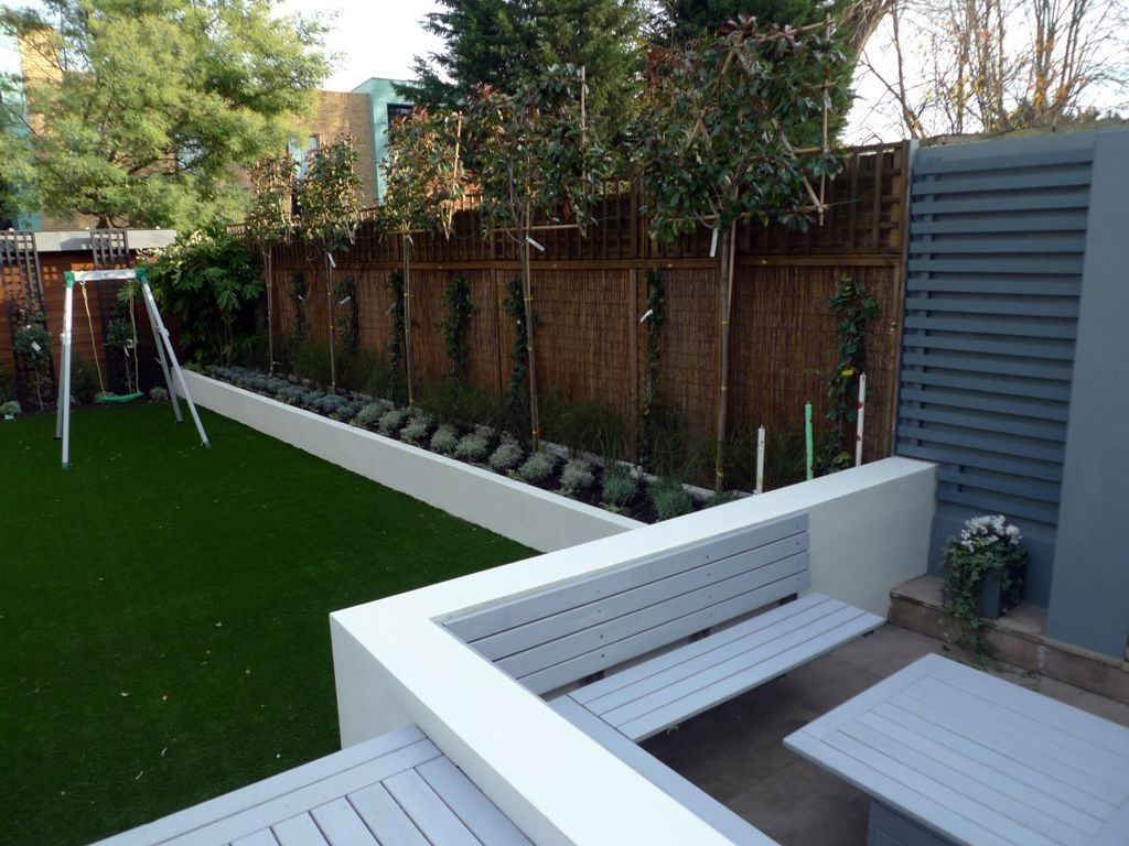Modern sleak garden low maintenance high impact garden for Modern garden decking designs