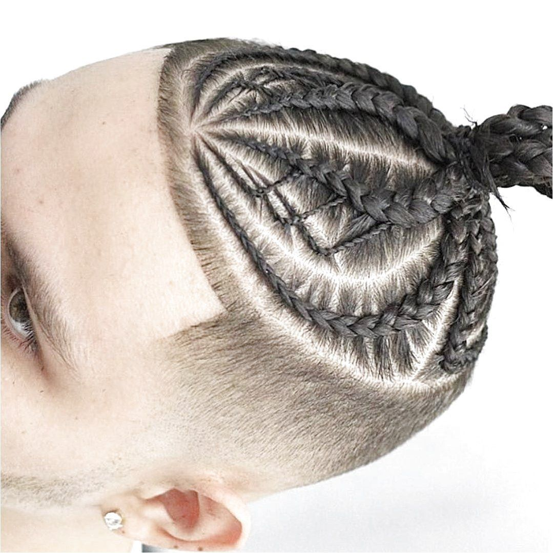 Braids And Buns Can Help To Keep Your Hair Looking Fashionable While Still Being Active And If You Wan Mens Braids Hairstyles Long Hair Styles Men Hair Styles