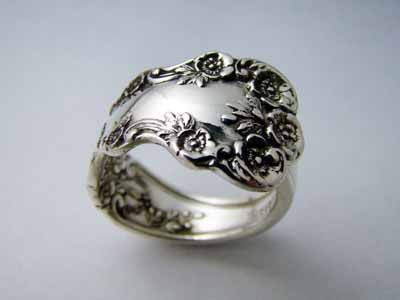 Spoon ring! Crazy what you can make out of the ornate handles.       Demitasse Sterling Silver Spoon Ring - Buttercup. $59.00, via Etsy.