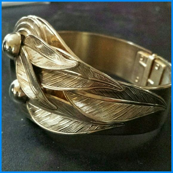 """Goldtone Hinged Cuff """"Power"""" Braceket When i put on this bracelet i feel a bit like Wonderwoman, those power cuffs! Goltone hinged bracelet. Intricate texture details on leaves. Multi dimensional. Hinge opening is 1.5"""". Diameter is 2.25"""". This bracelet while not vintage dates back to the 90s, maybe early 2000s. Jewelry Bracelets"""
