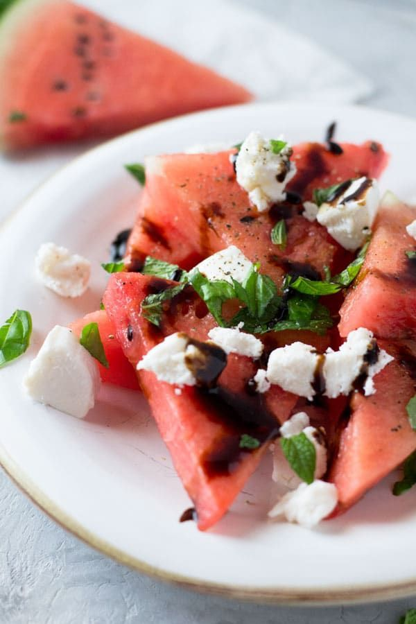 A delicious light watermelon, basil, mint, goats cheese salad with balsamic glaze. Refreshing and healthy salad recipe insidetherustickitchen