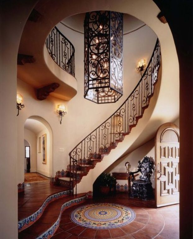 Mediterranean room with Pendant light, specialty door, Wall sconce, Wrought iron railing, High ceiling, Trim stairs tiles