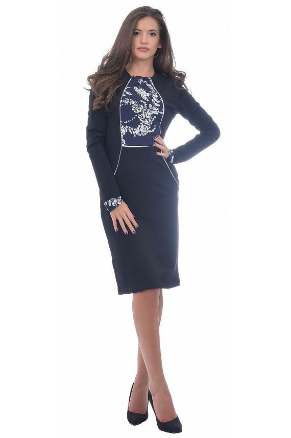 e6f35ce34a Tight black dress with length to the knees. The dress is made of very thick