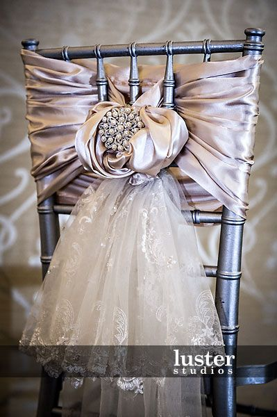 silver-chiavari-chair-covers. I like the drop of lace and how the back reminds me of a Victorian bustle back
