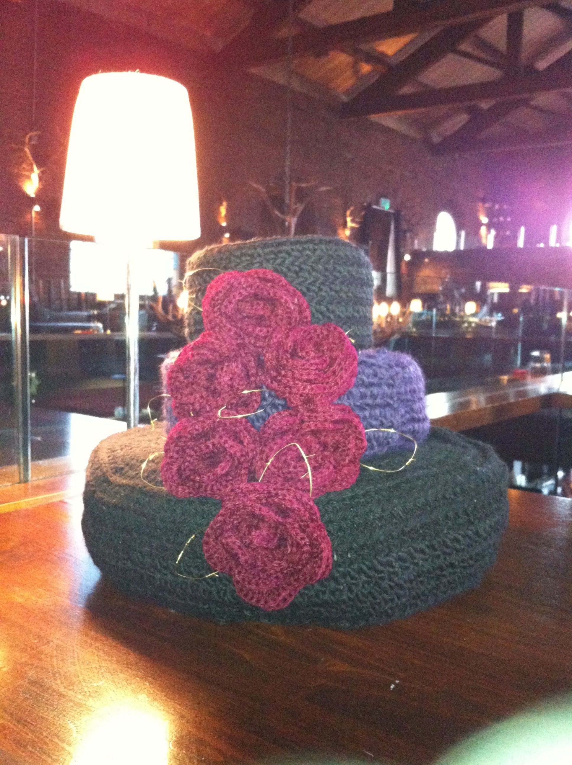 Three tiered crocheted wedding cake with roses and gold barbed wire