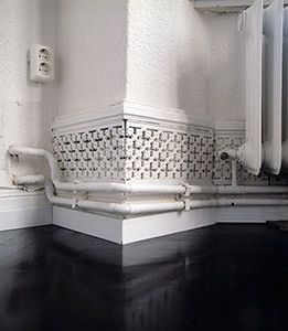 Plugging Holes Around Baseboard Heating Pipes | Home Tips