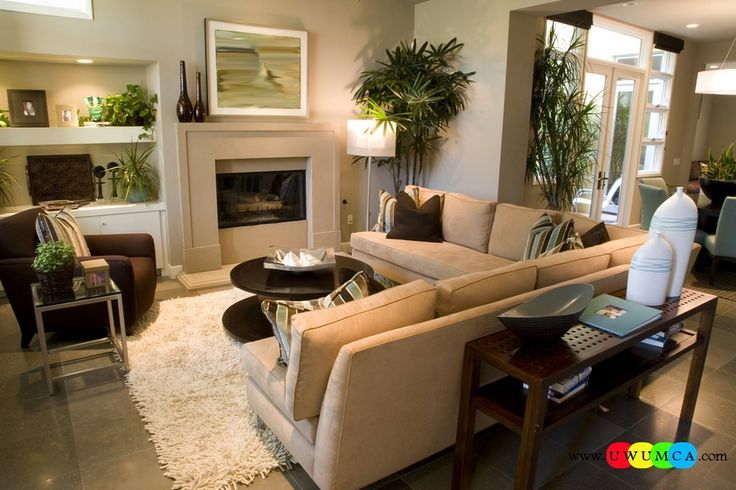 Decorating Rectangular Living Room this family room, cozy with a fireplace and built-in library