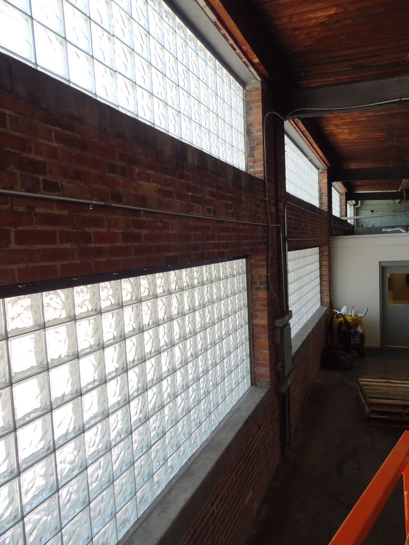Glass block windows in commercial buildings add style and energy using glassblock in industrial factory windows enhances natural light and can increase productivity energyefficient mozeypictures Image collections
