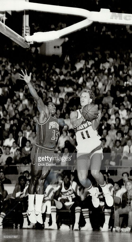 Toronto's Leo Rautins of Atlanta Hawks (11) leaps for the basket during NBA exhibition game at the Gardens last night as Vinnie Johnson of Detroit defends Rautins scored 15 points in his bid for a regular NBA job.