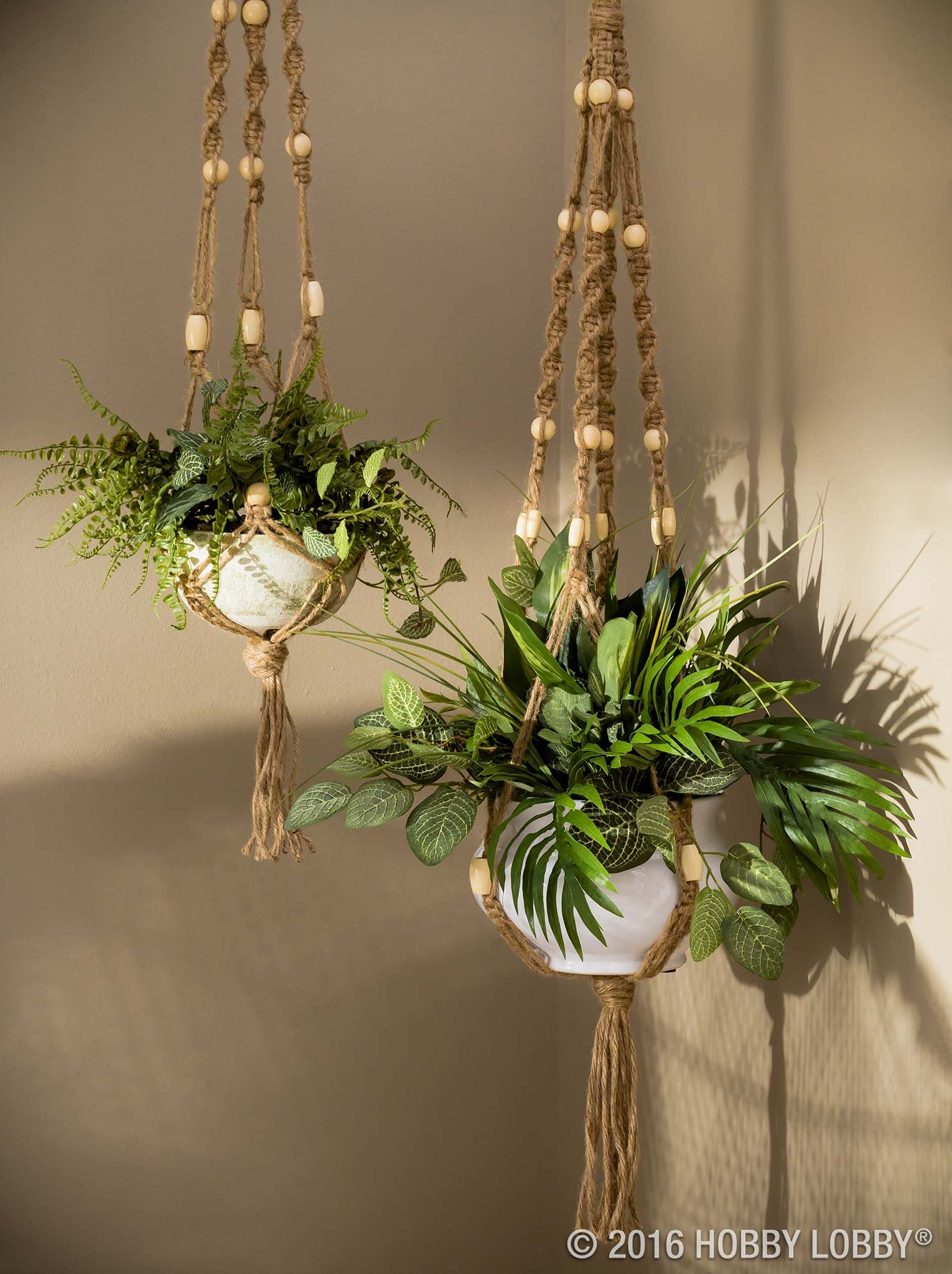 Add jute and beads to a plain planter for a boho twist on hanging planters!