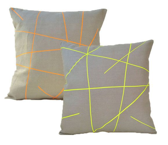 Neon striped throw pillow, great way to bring seasonal trends to your space is to change up your pillows.