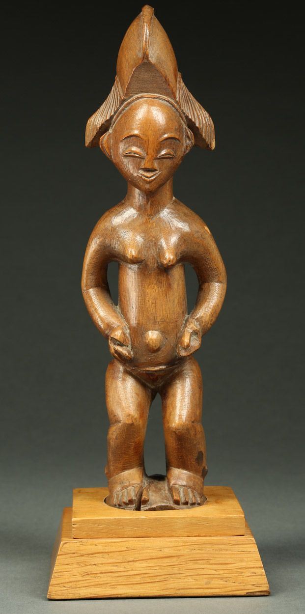 Beautiful and Refined Punu/Lumbo Figure (Parcours). Punu or Lumbo Tribe, Gabon, circa 1890-1900. This lovely figure has great appeal to us aesthetically and is important in light of the rarity of figures from this region. The wood is extremely old and dry and lightweight, giving one a sense of the fragility of the figure when it is being held - although the figure is not altogether any more or less fragile than a hardwood carving. This and more ethnographic art for sale on CuratorsEye.com.
