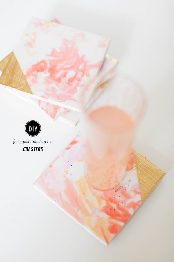 Pretty yet thoughtful, these DIY finger paint tile coasters make for the perfect gift for Mom.