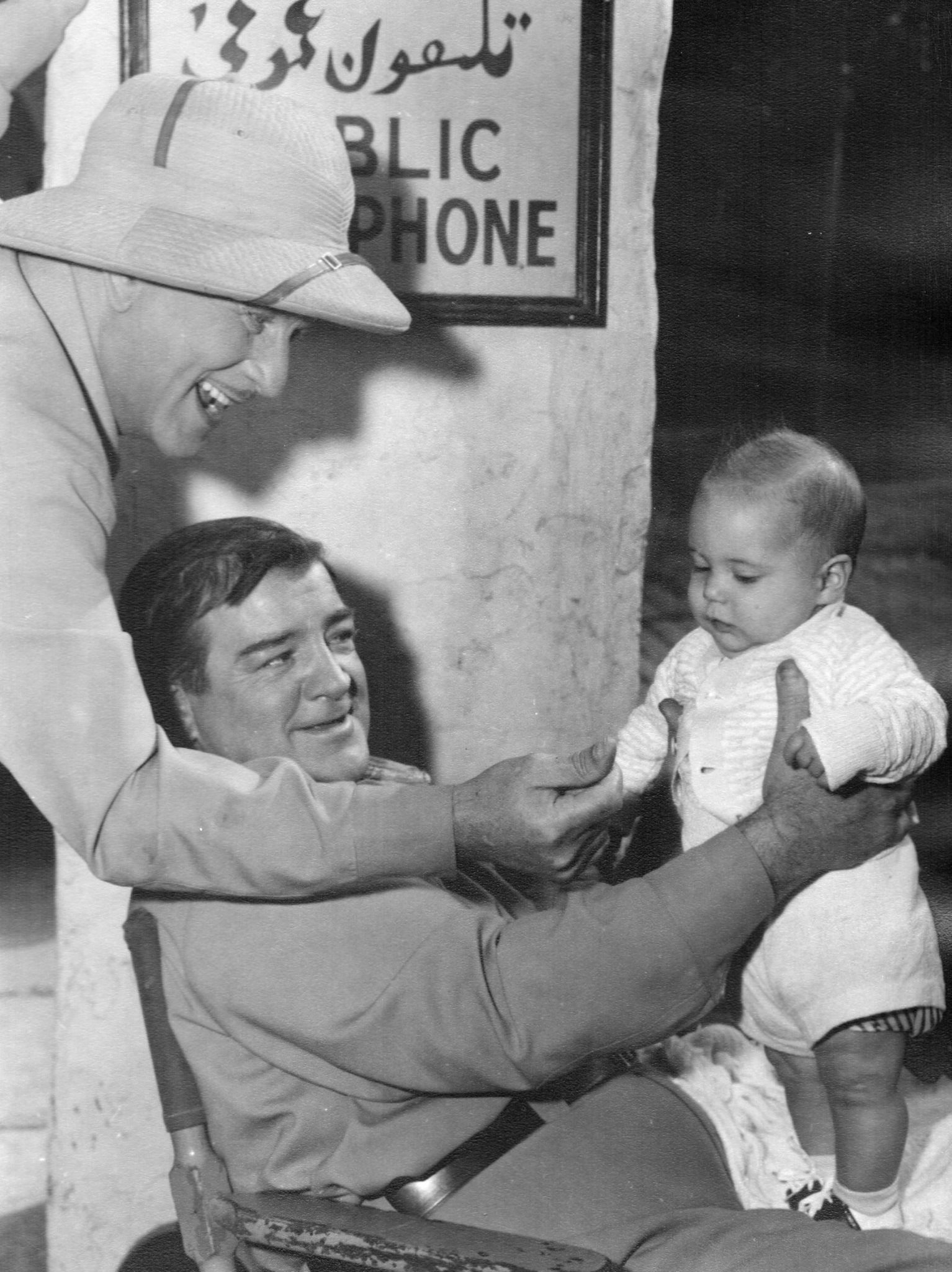 lou costello showing off his first grandchild on the set of abbott
