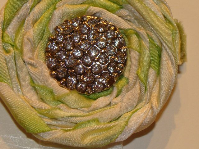 AMAZING hand dyed silk hand rolled rosettes on a velvet clip (sold)