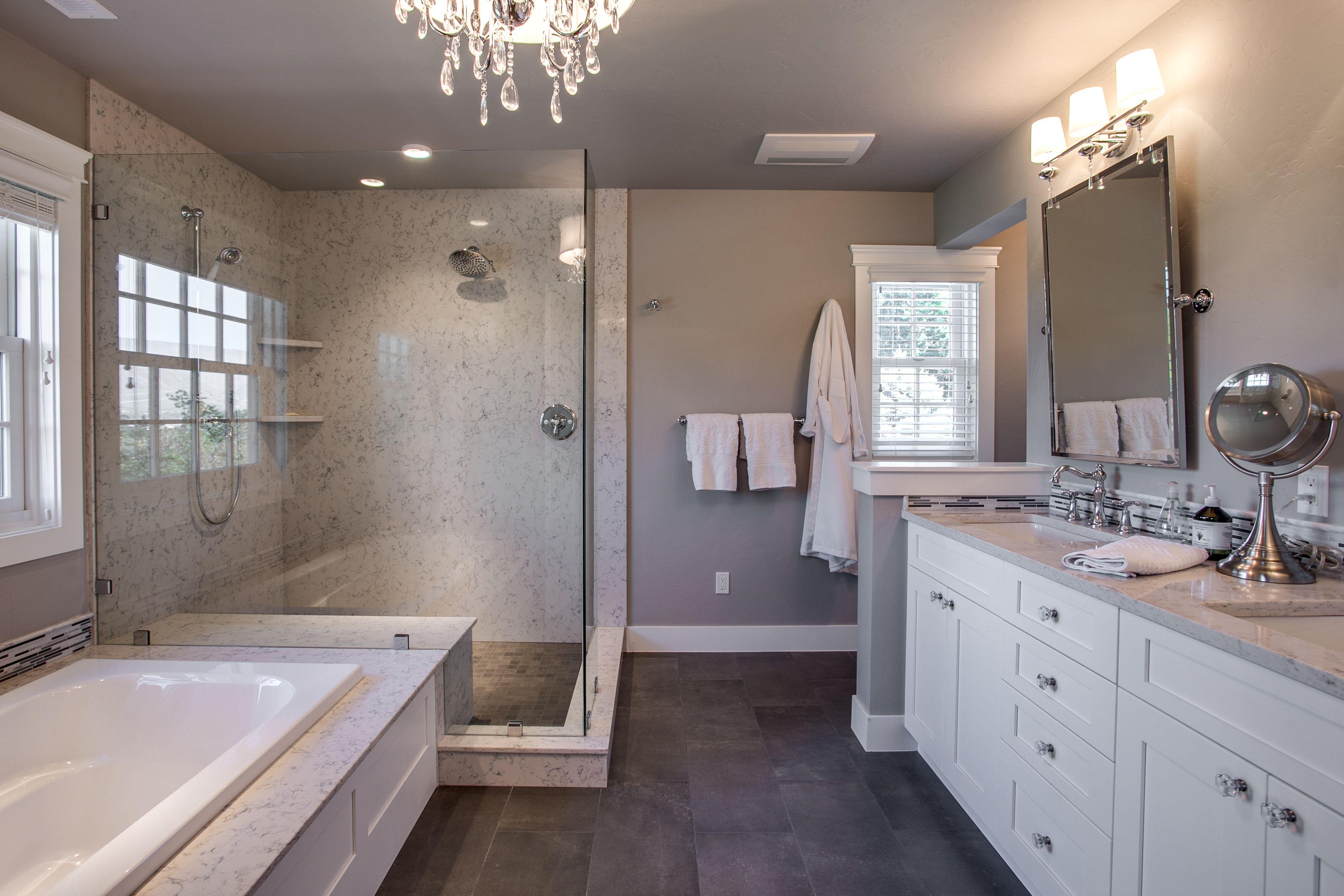 Quartz slab shower with Columbia Cabinets in iceberg white ...