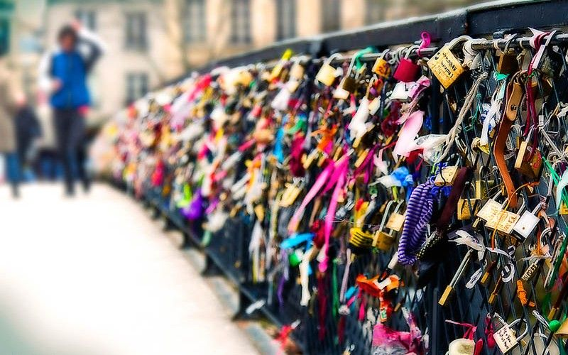 I want to go!! LOVERS BRIDGE IN PARIS - lovers fasten padlocks to the railings of the Pont des Arts bridge in Paris. The couple then toss the keys into the Seine river below, symbolizing their eternal love...