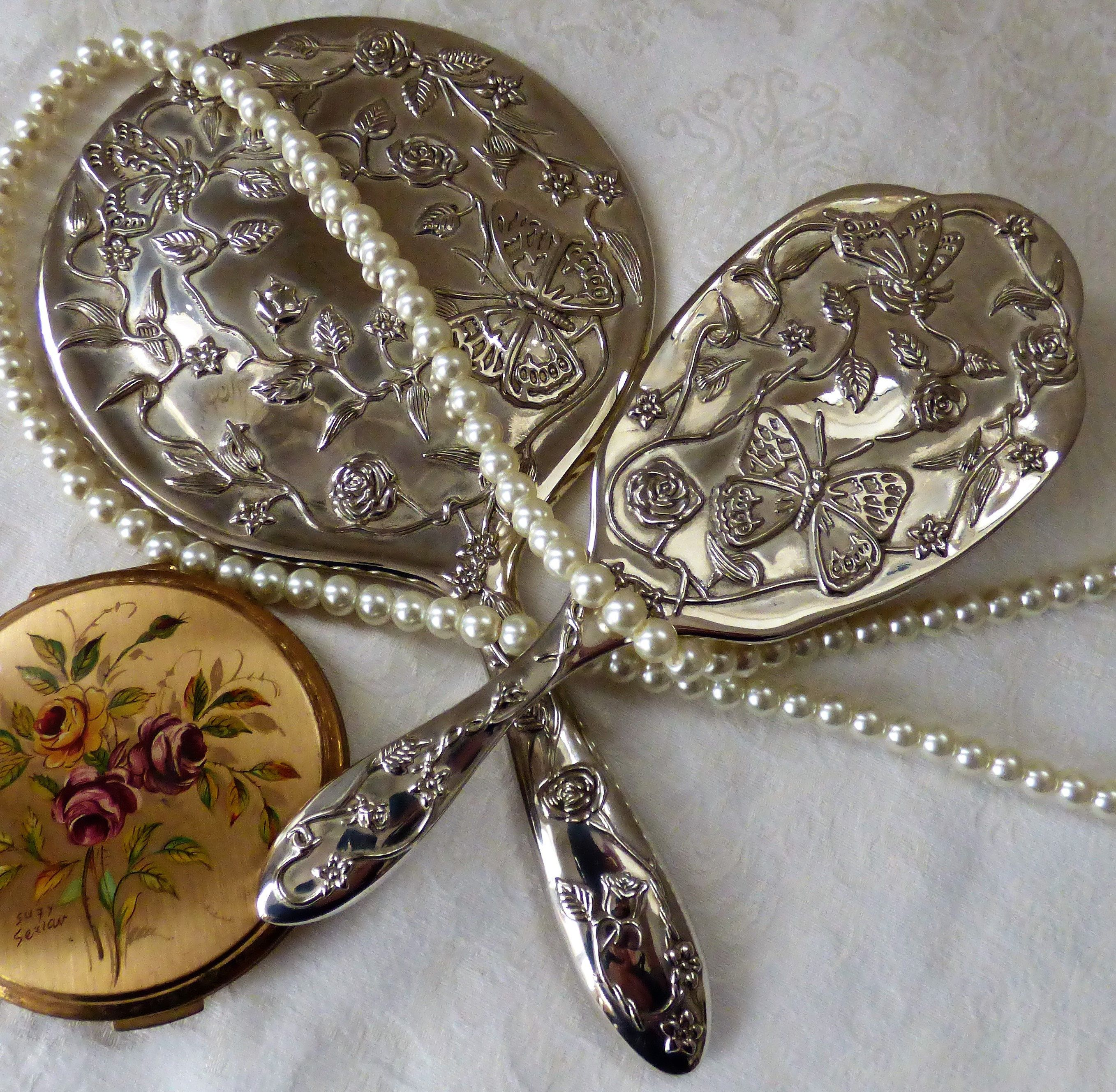 A superb vintage two piece silver plated vanity set decorated with butterflies and entwining roses Such a lovely gift. & A superb vintage two piece silver plated vanity set decorated with ...