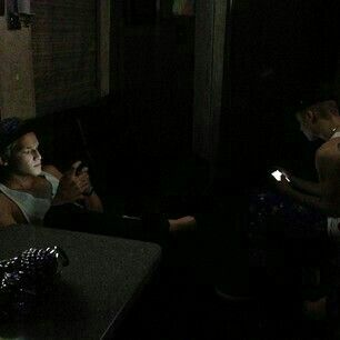 Justin and Cody Simpson. On their phones.