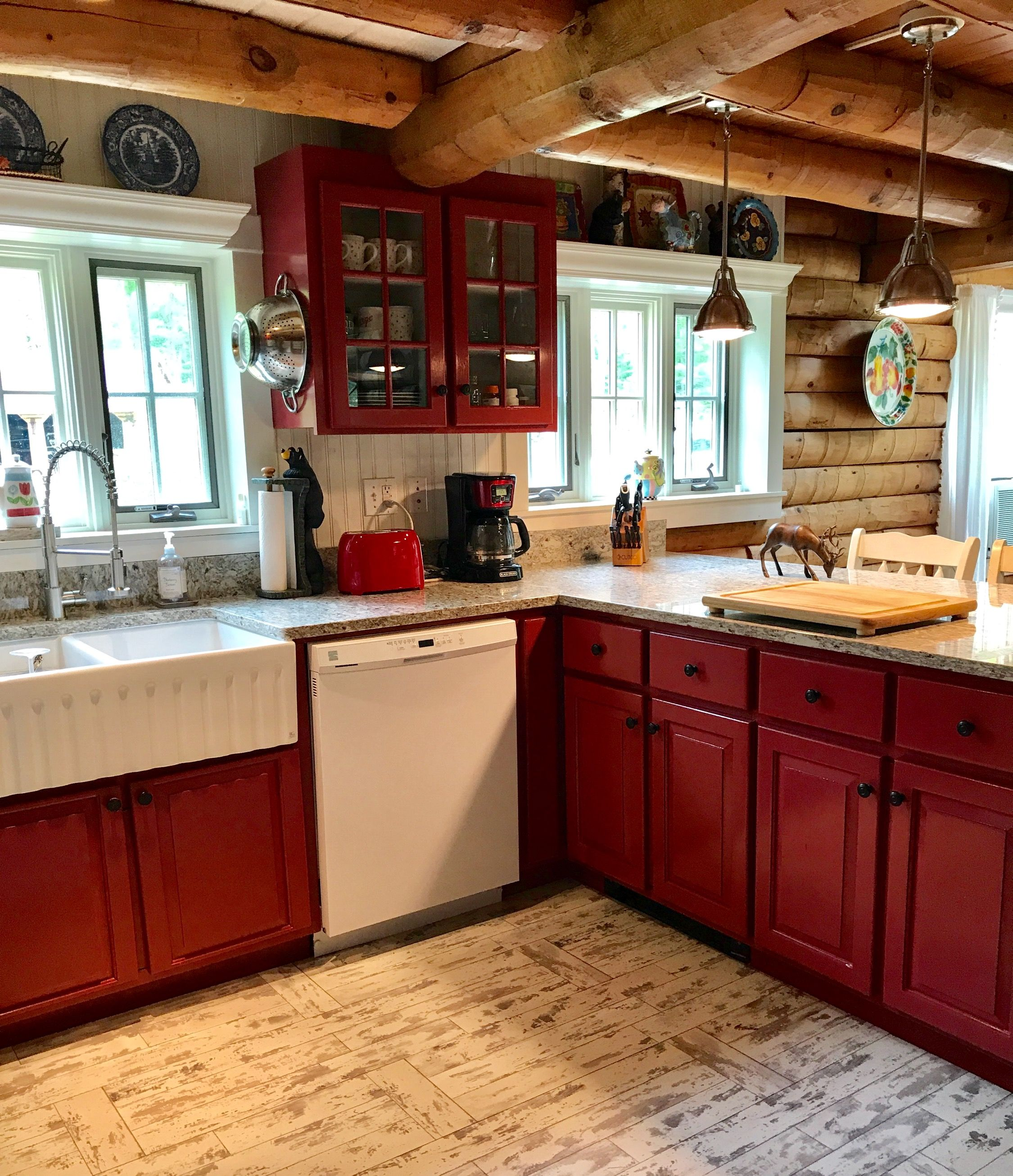 Log Cabin Kitchen With Red Painted Wood Cabinets So Charming Log Cabin Kitchens Cabin Kitchens Log Home Kitchens