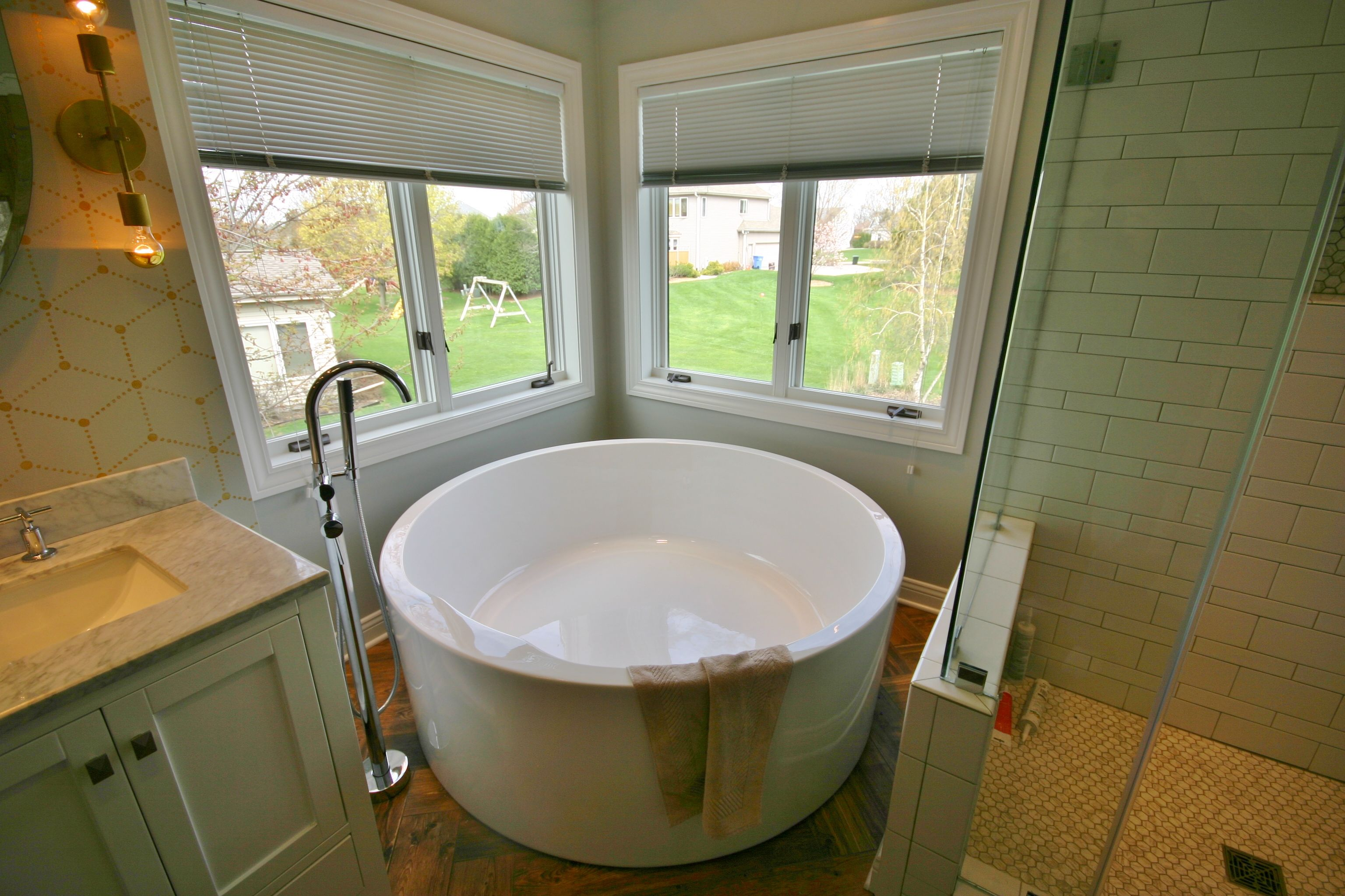 Round Soaker Tub, Walk In Tile Shower, Double Vanity, Shampoo