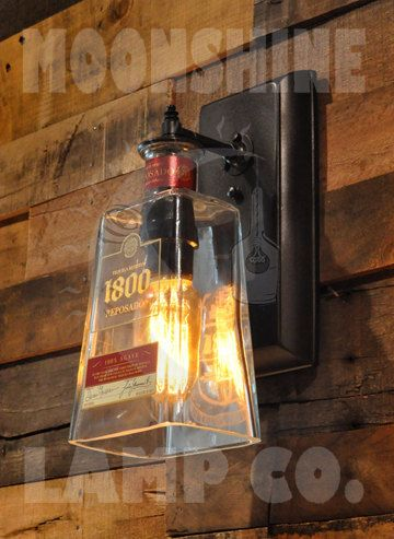 This is a wall sconce made from a hand-cut 1800 Reposado Tequila bottle. The brass hardware and wall plate can all be left in unfinished brass or can be finished in black or oil rubbed bronze. Included is an old fashioned style 30 watt Radio Tube bulb. Max wattage is 40 watts. I do have a huge inventory of bottles, so if you have a different one in mind, please let me know.  Rob www.moonshinelamp.com 818-621-4089