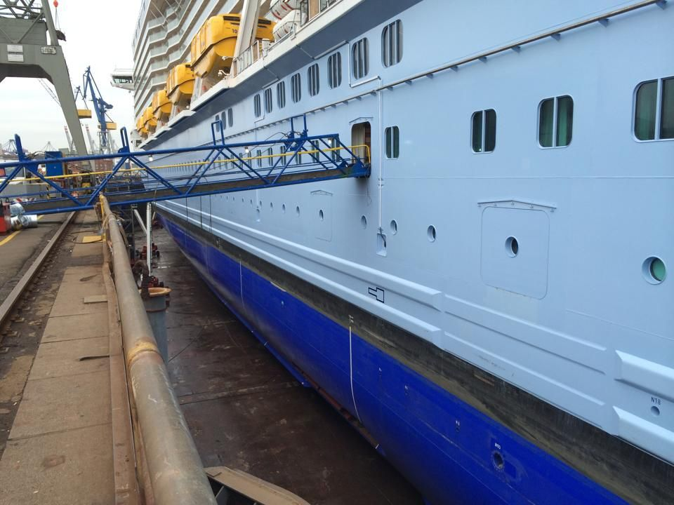 The Quantum of the Seas out of the water in dry dock at Blohm + Voss Dock Elbe 17 in Hamburg, Germany.
