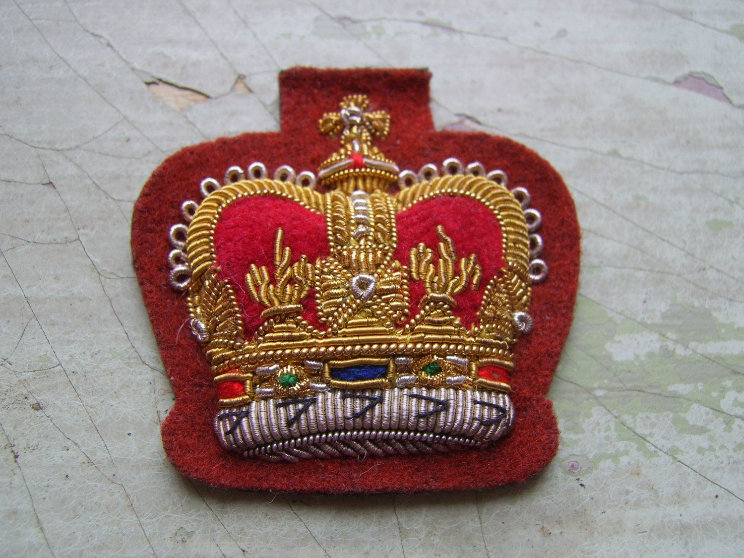An attractive antiquevintage embroidered military patch