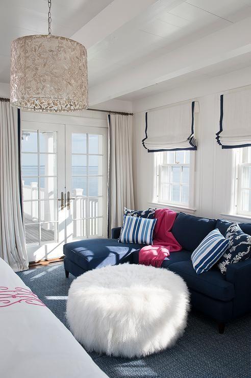 Fantastic bedroom sitting area boasts a dark blue sofa withs