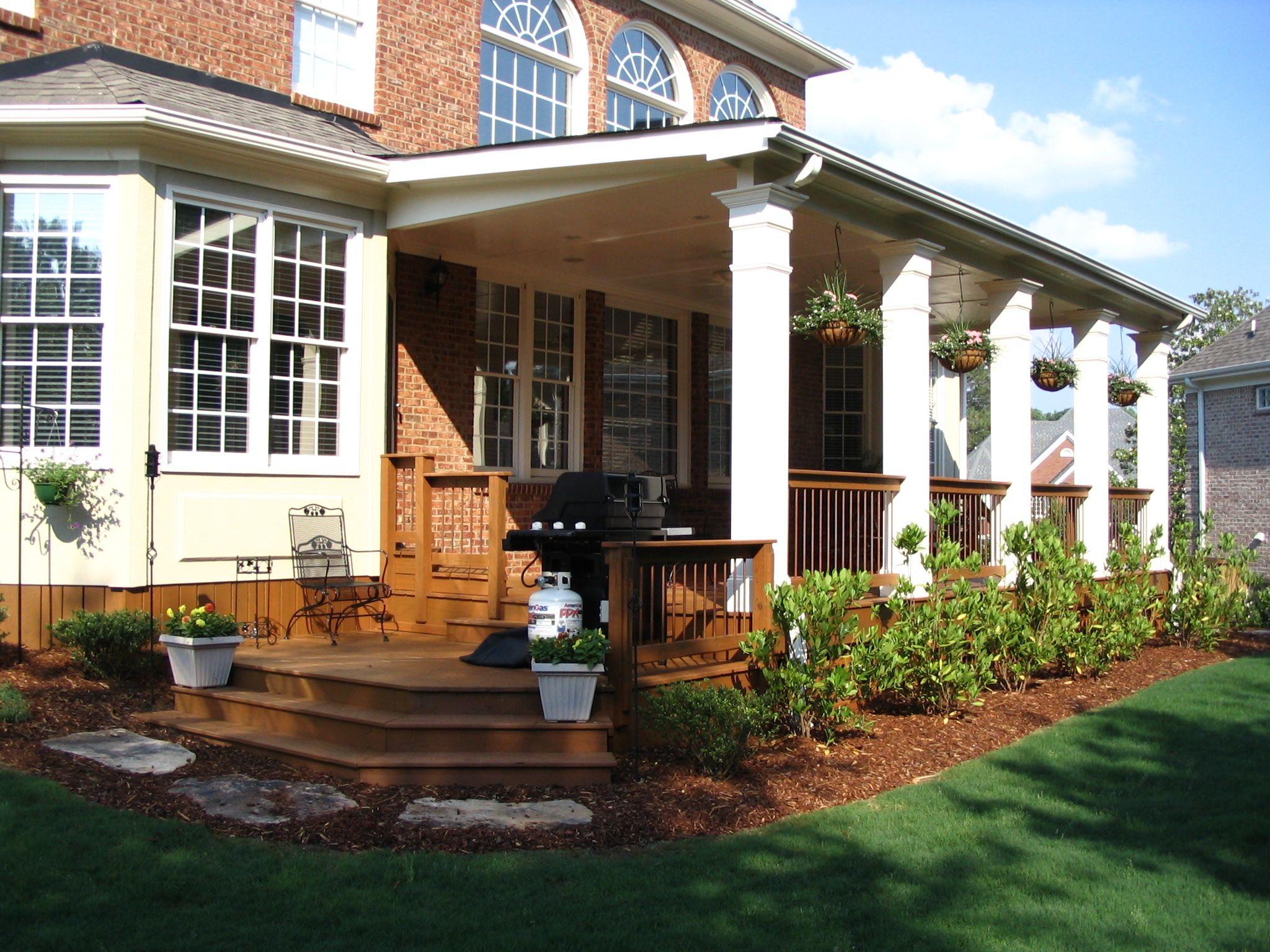 a nice expansive open back porch with square columns set off this
